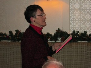 Toastmaster Eilish Ni Bhriain reading poetry at the annual Club Christmas Party December 2013.