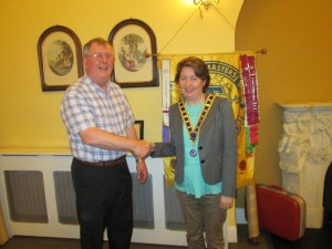Handing on the chain of tradition: Outgoing president, Gerry Hennessy congratulates our president for 2014-15, Mary Whelan.