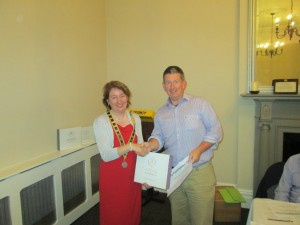 Club President Mary Whelan congratulates  Frank O'Driscoll  on winning the recent Club Humorous Speech Contest.