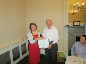 Club president Mary Whelan congratulating John Quirke on winning the clubs topics competition