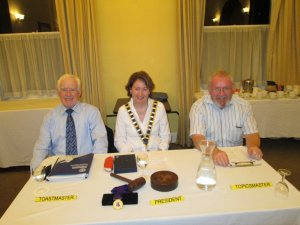 Club president Mary Whelan with Toastmaster for the evening John Kelly and our inimitable smiling Topicsmaster, John Sherlock at our meeting on August 21st
