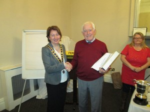 John Kelly Recieves the compliments of club president Mary Whelan, as Winner of the Evaluation Contest . March 10th 2015