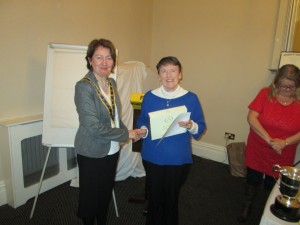 Eilis Ui Bhriain recieving her presentation as Alternate Winner of the Club Speech Contest from our President Mary Whelan.