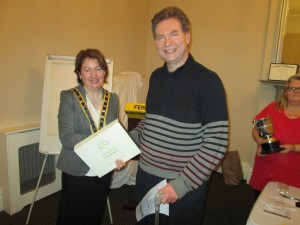 President Mary Whelan congratulates Kvin Walsh as Winner of the 2015 Club Speech Contest. Maura Corbett prepares to present him with the Niall Brunicardi Perpetual Trophy.