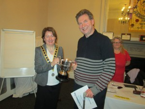 Engraved with the names of many past winners, Club President Mary Whelan congratulates Kevin Walsh on Retaining the Niall Brunicardi Perpetual Trophy