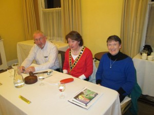 Club President Mary Whelan flanked by Topicsmaster Eilis Ui Bhriain and Toastmaster for the evening John Sherlock at the club meeting ob March 24th 2015.