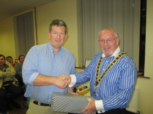 Frank O'Driscoll (left) is congratulated by Club President John Sherlock as winner of the Humorous Speech Contest October 6th2015