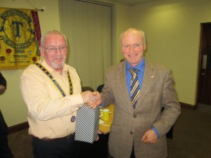 Handshakes and congratulations to Pat Sexton as First Placed Speaker in the Area Table Topics Contest from Club President John Sherlock.