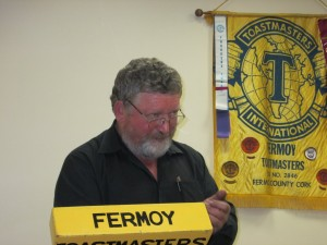 With the Fermoy Toastmasters Club banner prominently displayed, Liam Flynn of Mallow addresses the audience at the October 2015 Area & Topics Contest of which he was the very affable and successful chairman.