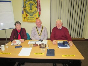 The Top Table for the November 17th 2015 meeting:- President, John Sherlock (centre); Toastmaster, Eilish Ui Bhriain (left); and Topicsmaster, John Kelly. Three happy and smiling faces so eloquently expressive of the happy and welcoming spirit of Fermoy Toastmasters.