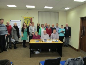 Members and friends of the Fermoy Toastmasters Club smile for the camera after their very entertaining meeting on December 1st 2015