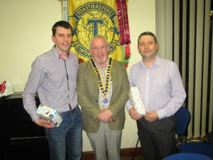 Club President John Sherlock with Evaluations Contest Winner Fanahan Colbert and Runner-Up Padraig Murphy.