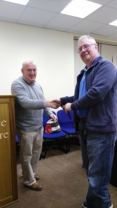 General Evaluator John Sherlock presents Jerry Hennessy with the Blue Ribbon for Best Evaluator at the Club Meeting of November 8th 2016.