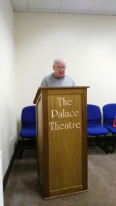 General Evaluator John Sherlock gives his overall assessment of the Club Meeting of November 8th. On the night the Fermoy Youth Centre needed our regular lectern as a theatrical prop and kindly substituted with their own bearing the legend The Palace Theatre evoking that time when this centre flourished both as a cinema and music hall where so many productions of the Fermoy Choral Society were staged, as they still are. A place of entertainment over very many years before becoming the permanent recreational centre for local youth, its walls have seen so many wonderful and happy occasions. And now as our new venue for our Toastmasters meetings, it continues to be a place of that very special eloquence, friendship, personal growth and immense enjoyment that comes with membership of our cherished club.