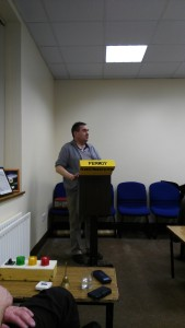 Seoirse Neilan delivers his Evaluation at the Club Meeting of November 22nd. In the lower left corner of picture can be seen the green, amber and red lights operated by the Timekeeper.