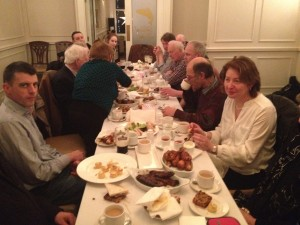 A view from the other end of the table as members and guests enjoy some refreshments.
