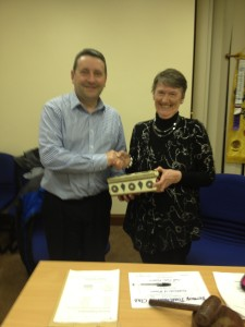 Eilis Ui Bhriain recieving her prize fro toastmaster Fanahan Colbert having won the tall tales contest.
