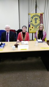 Club President Eilish Ui Bhriain presides at our St. Valentine's Night gathering with Topicsmaster Michelle O'Brien and Toastmaster/ Chairman John Kelly.