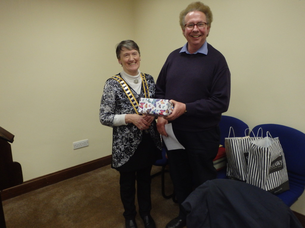 Eilish Ui Bhriain receives her Runner-Up Prize from Toastmaster of the evening David Walsh in the Club Speech Contest March 14th 2017.