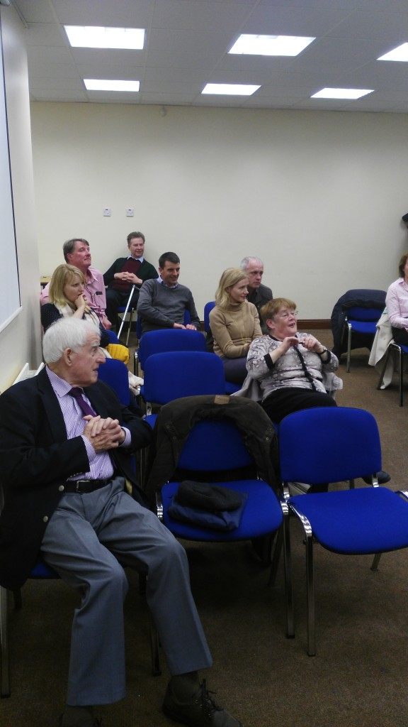 An interesting study of contrasting expressions as members and participants pictured here relax and enjoy the evening's entertainment.