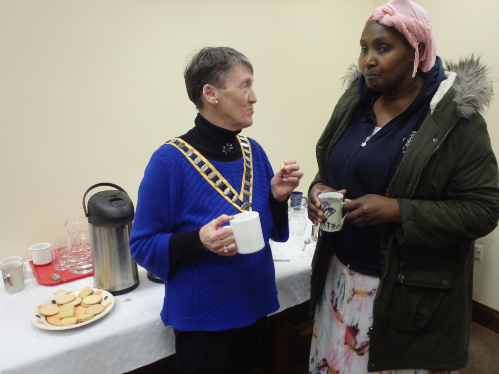 Club President Eilish Ui Bhriain shares a cup of tea and genial chat with our newest member, Angela Negethe, during the tea-break of the club meeting on March 28th 2017.