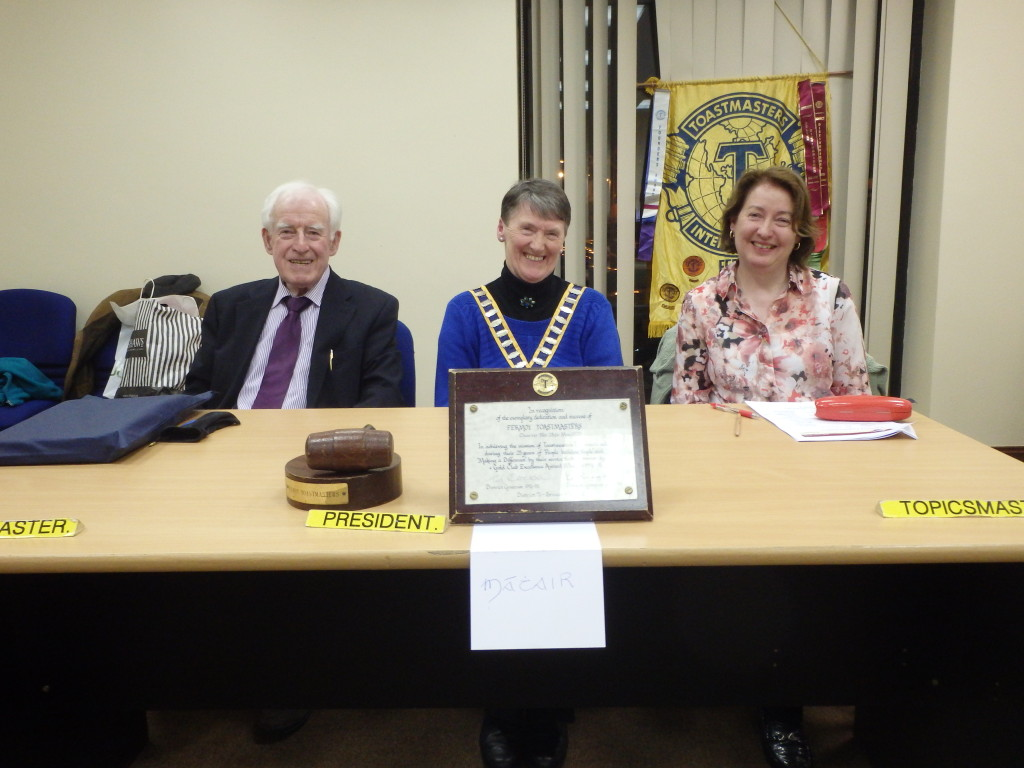 With relaxed warm smiles Club President Eilish Ui Bhrian presides on March 28th 2017, flanked by Topicsmaster Mary Whelan (right) and Toastmaster of the evening, John Kelly.