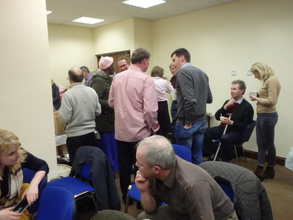Members and friends gather to enjoy the geniality of the tea break.