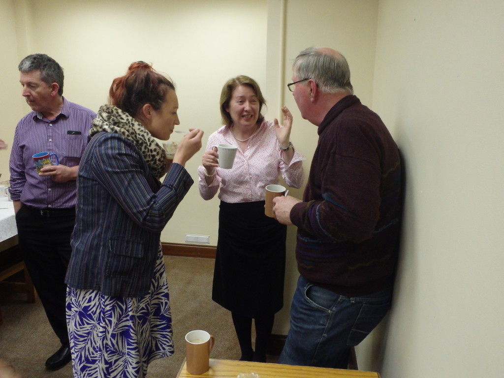 Helsa Giles (left) and Mary Whelan congratulate Jerry Hennessy on the gorgeous trifle desserts he prepared for the club meeting, April 11th 2017.