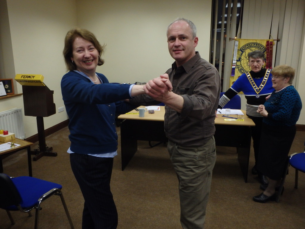 Mary Whelan and Kevin O'Neill prepare to jive as part of Kevin's speech about dancing at the April 25th meeting. Warm smiles speak volumes of how much this occasion was being so much enjoyed with the very greatest pleasure shared by all.