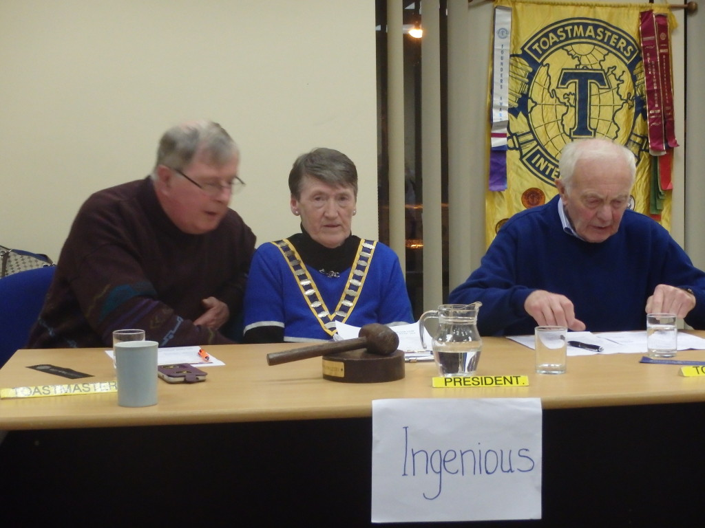 An interesting study of facial expressions of the Top Table with Eilish Ui Bhriain, Club President, with Toastmaster of the evening, Jerry Hennessy (left) and John Quirke who gave us a scintillating topics session. The legend on the sign proclaims 'Ingenious', the word of the night which members are invited to include in their contributions and speeches.